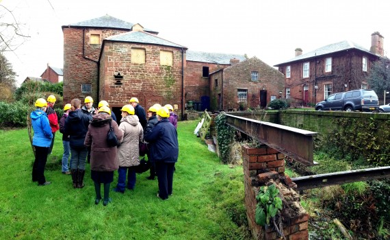 Volunteers in the grounds at Warwick Bridge Corn Mill