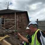 two men inspecting roof July 2016