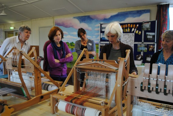 people learning weaving skills