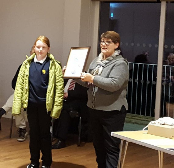 presenting prize to comp winner