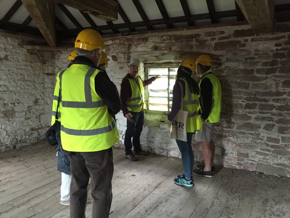Visitors looking at window detail inside Warwick Bridge Mill